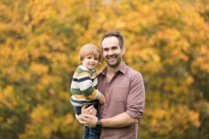 professional family photograph of father and son by family photographer Beautiful Bairns Photography Edinburgh taken at Holyrood Park Edinburg