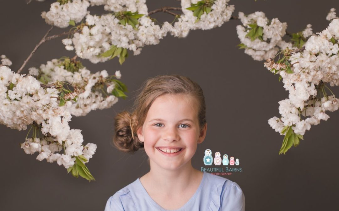 professional studio photo portraits of girl surrounded by blossom by beautiful bairns photography in Edinburgh