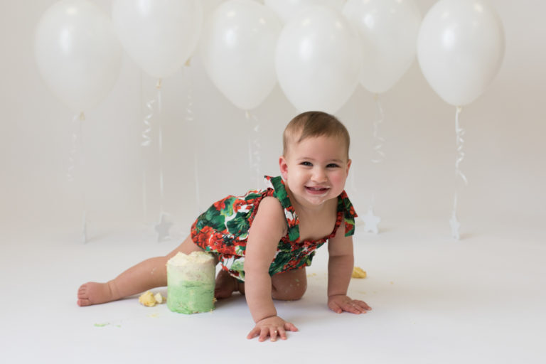 photo of one year old enjoying cake smash photo by beautiful bairns photography Edinburgh