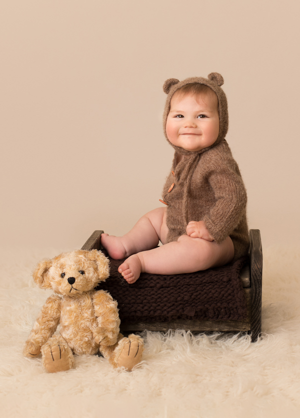 photo of baby boy in teddy bear outfit by professional baby photographer beautiful bairns photography edinburgh