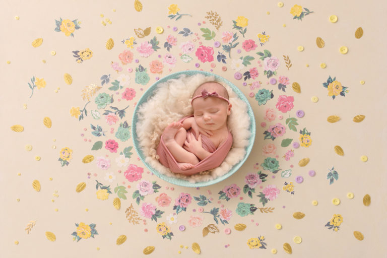 professional photo of baby girl in bowl with fluffy rug and flower petals by newborn baby photographer beautiful bairns photography edinburgh