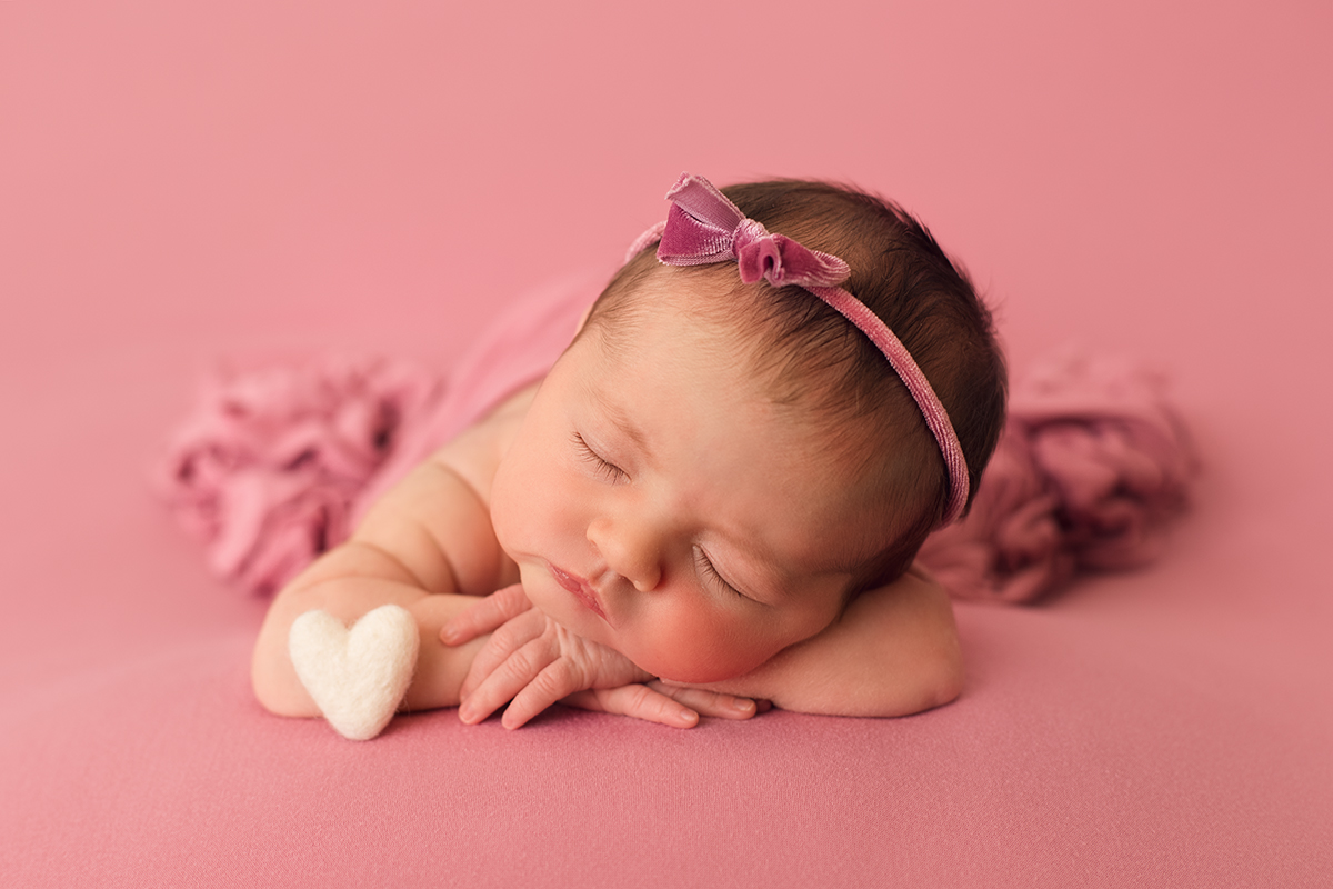 photo of newborn baby girl on pink blanket by professional newborn baby photographer beautiful bairns photography edinburgh