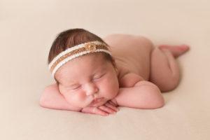 professional newborn photo of newborn baby girl on cream fabric by professional newborn photographer beautiful bairns photography edinburgh