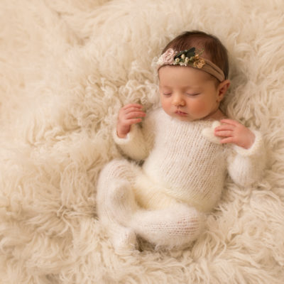 baby photo of baby girl in cream outfit on fluffy rug by professional newborn baby photographer beautiful bairns photography Edinburgh