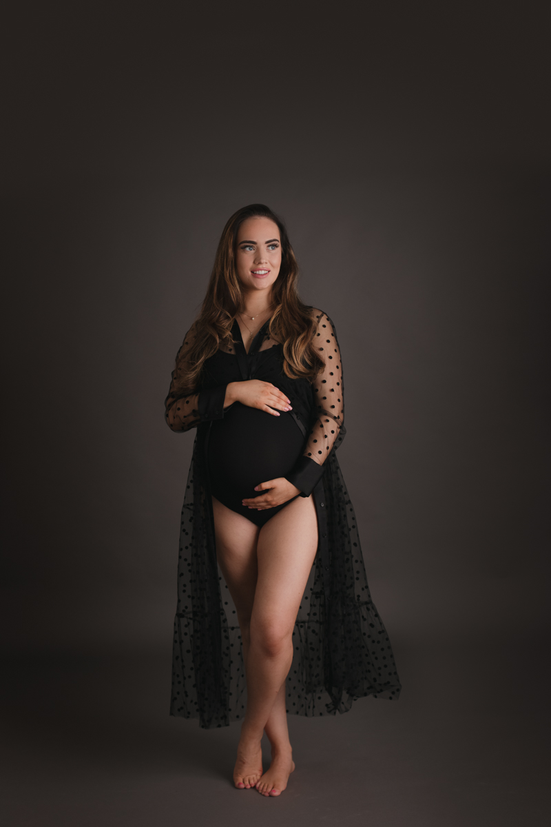 maternity portrait photo of heavily pregnant woman wearing black dress by maternity photographer beautiful bairns photography Edinburgh
