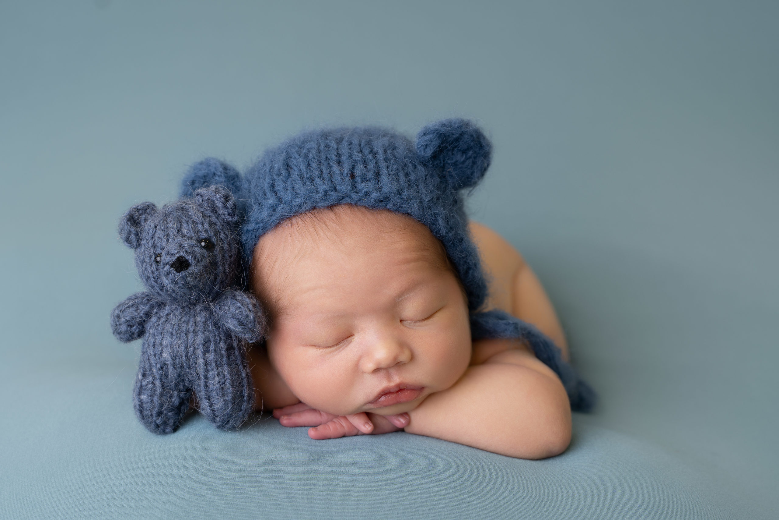 professional newborn photo of newborn baby posed on teal blanket by newborn photographer edinburgh beautiful bairns
